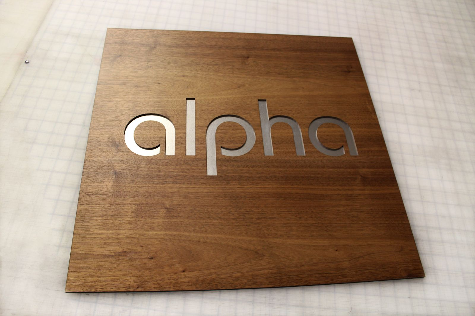 aluminum and wooden sign