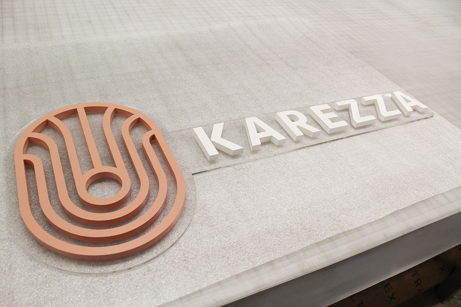 Karezza giant 3d letters and logo sign painted with Matthews Intermix System and made of acrylic for reception branding