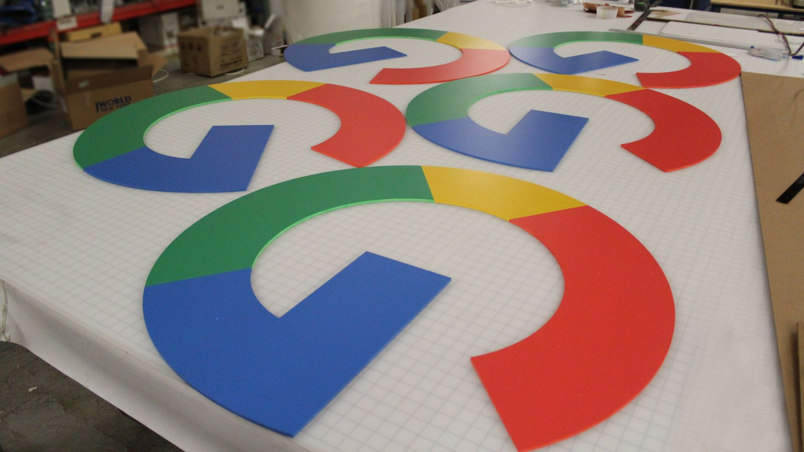 Google 3d plastic logo signs in bright brand colors made of PVC displayed on the table before installation