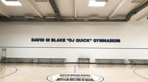 David M Blake Dj Quick Gymnasium 3d metal letters painted in blue made of aluminum for basketball court interior branding