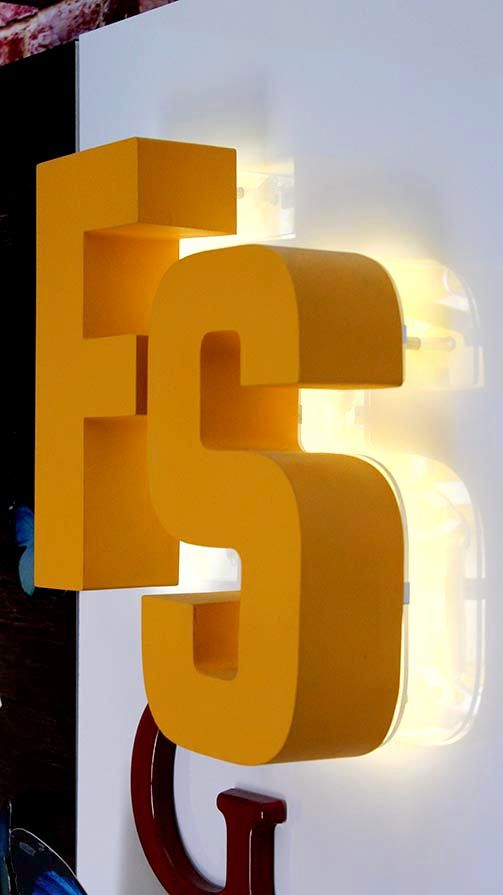 big backlit 3d metal letters F and S painted in yellow color made of aluminum and acrylic