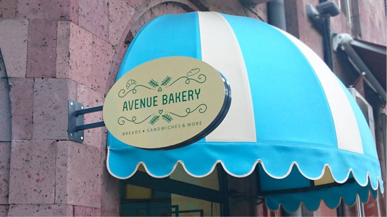 Avenue Bakery custom light box with bakery symbols made of acrylic and aluminum for brand outdoor promotion and visibility