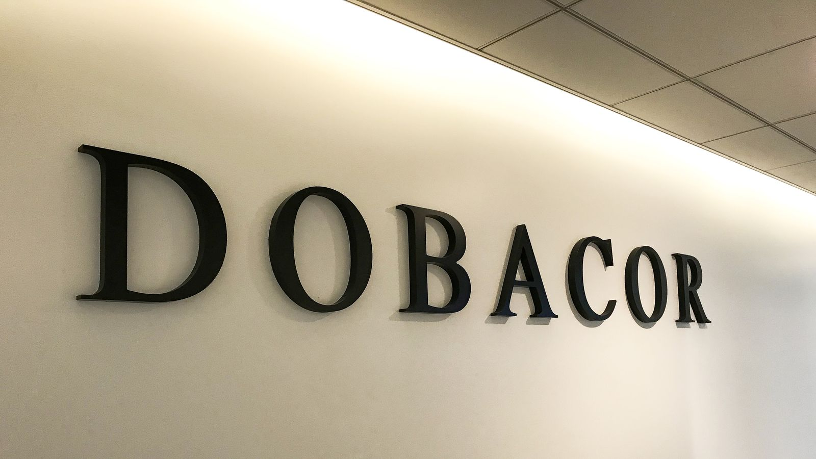 Dobacor 3d office sign in black color displaying the company name made of acrylic for interior branding