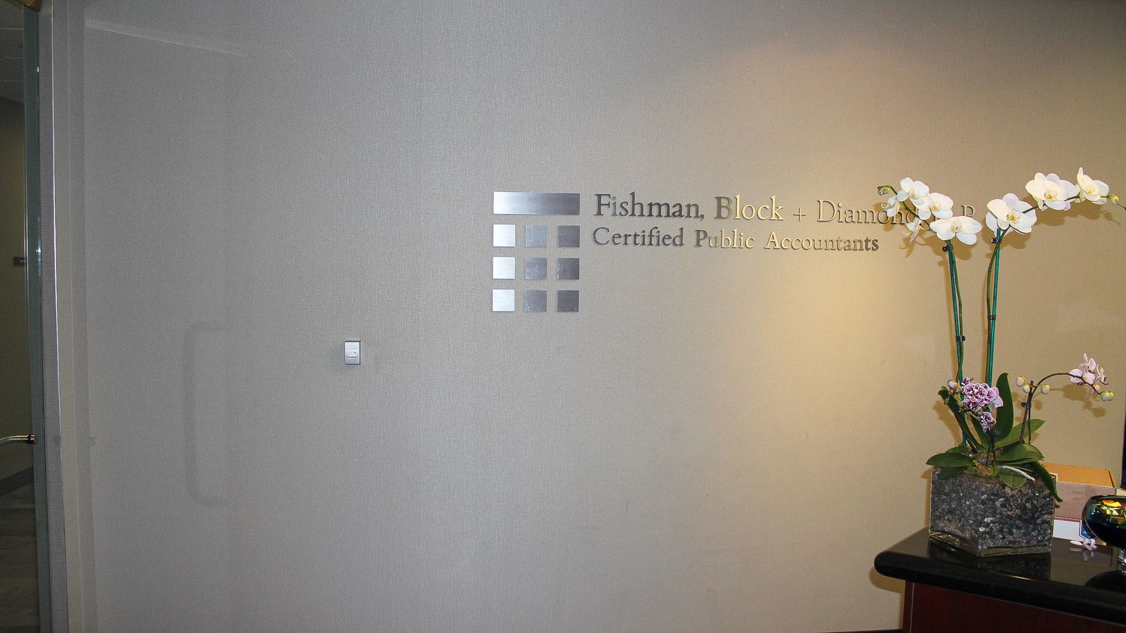 Fishmanm Block+Diamond, LLP Certified Public Accountants office lobby sign made of brushed aluminum for interior branding