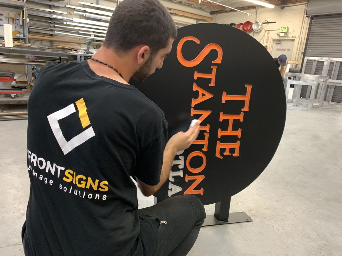 The Stanton DTLA light box sign in a round shape made of aluminum and acrylic