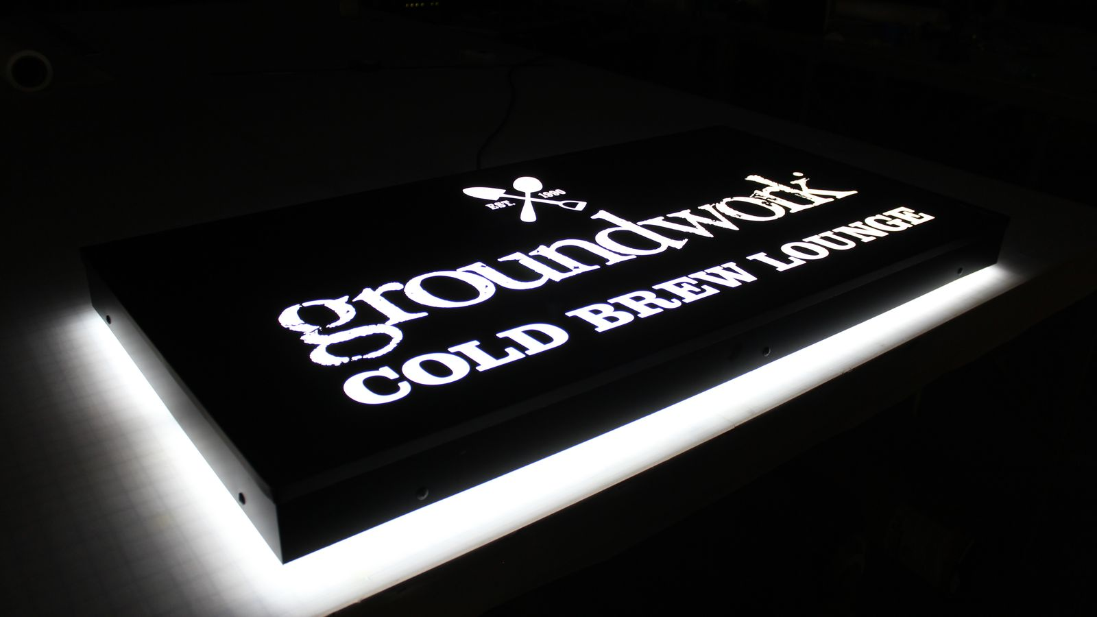 Groundwork Cold Brew Lounge LED light box with the company logo made of acrylic and aluminum for brand nighttime visibility
