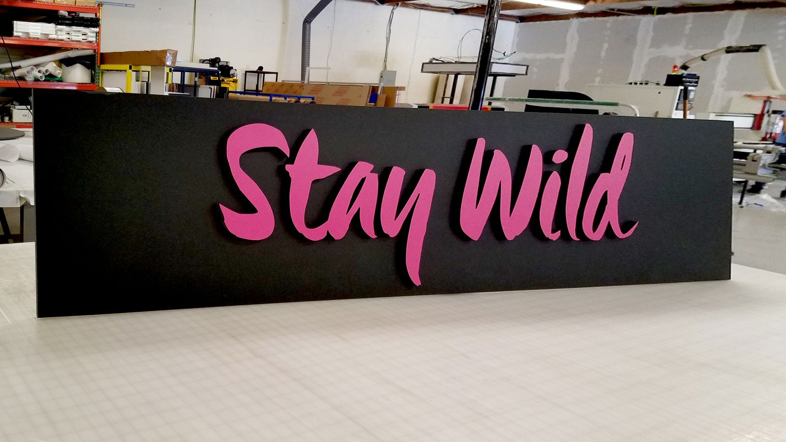 Stay Wild 3d foam letters and stand sign in pink and black colors made of gatorboard before the signage installation