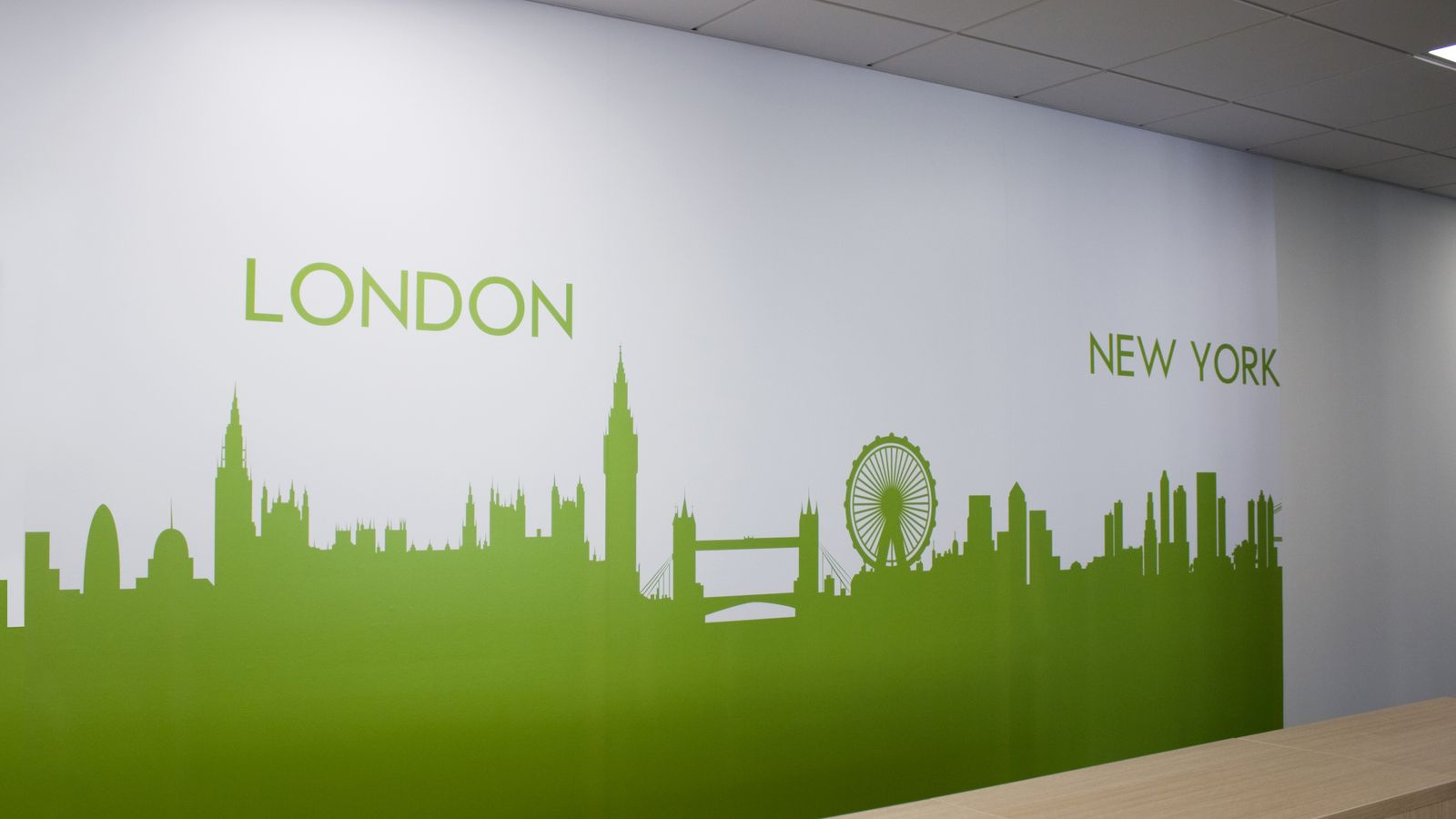 decorative interior wall sign with New York and London skyline graphics made of opaque vinyl for indoor branding
