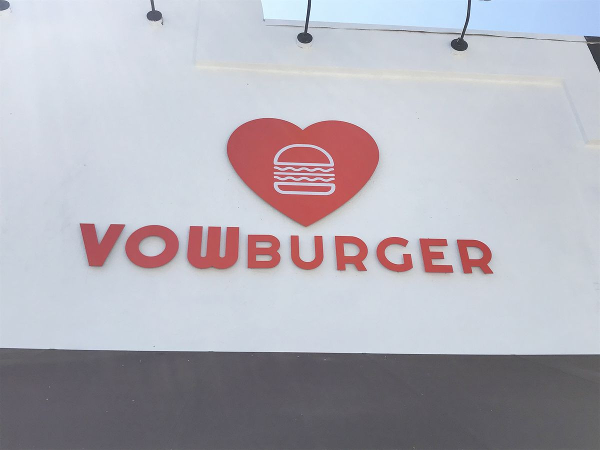 Vowburger 3d metal sign in red displaying the company logo and name made of aluminum for restaurant branding outdoors