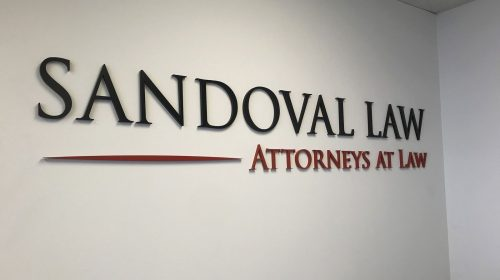 Sandoval Law 3d acrylic letters painted in black and red displaying the company name