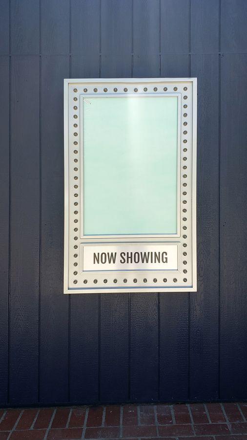 aluminum cinema sign