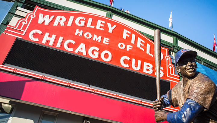 custom baseball field signage with a player statue displayed at the entrance