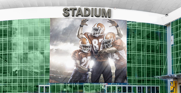 large stadium signage fixed to the building facade