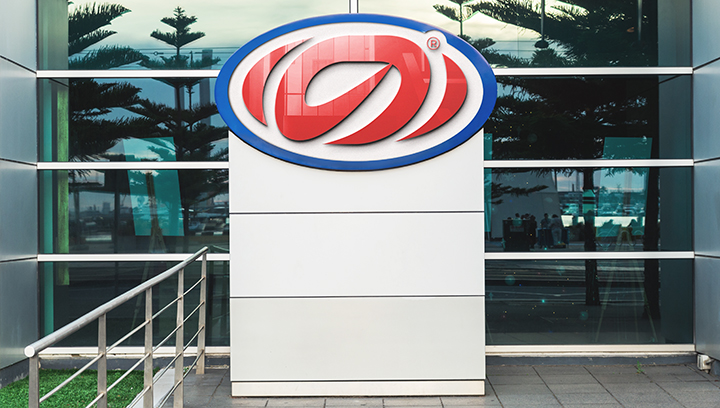 outdoor stadium plaza sign displaying a red logo