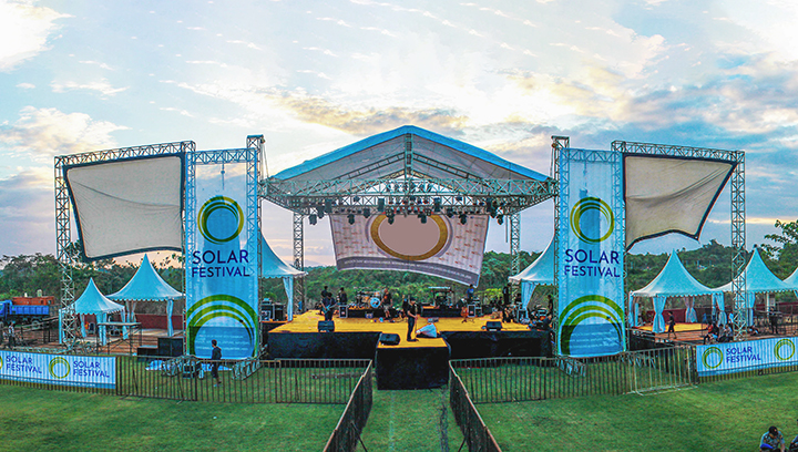 Solar Festival signs in blue displaying branded graphics outdoors