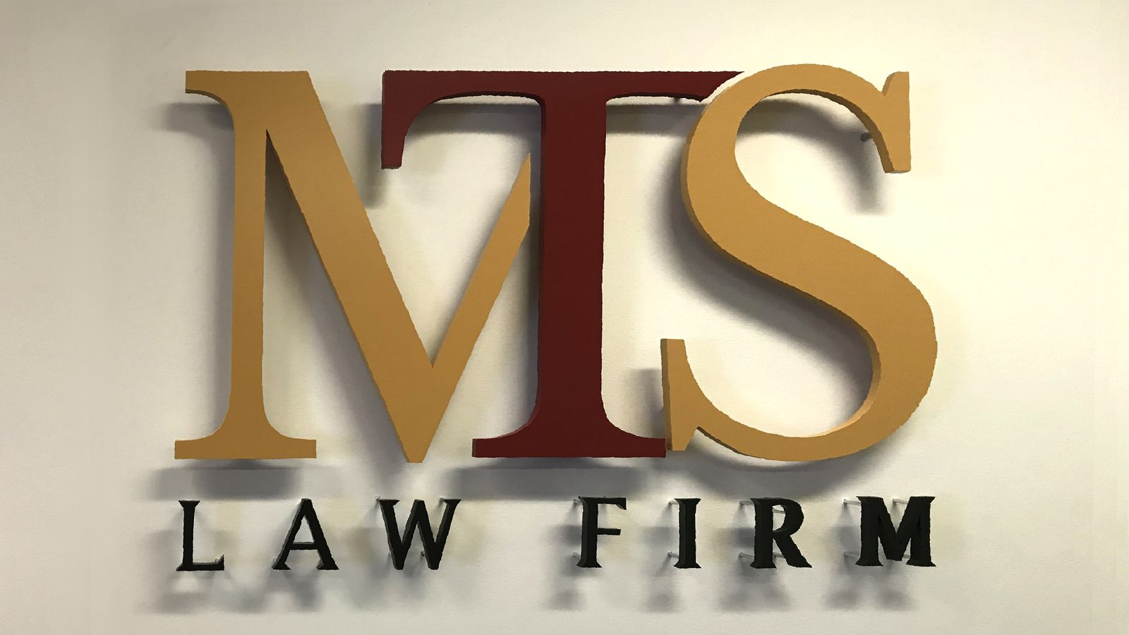 MTS Law Firm 3d office sign displaying the company logo and name made of painted aluminum