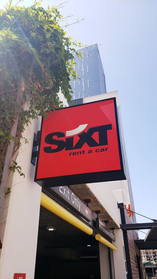 Sixt outdoor light box in a square shape made of acrylic and aluminum for car rental company promotion and visibility