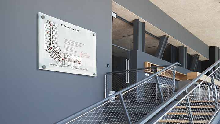 informational arena sign displaying evacuation plan fixed to the wall