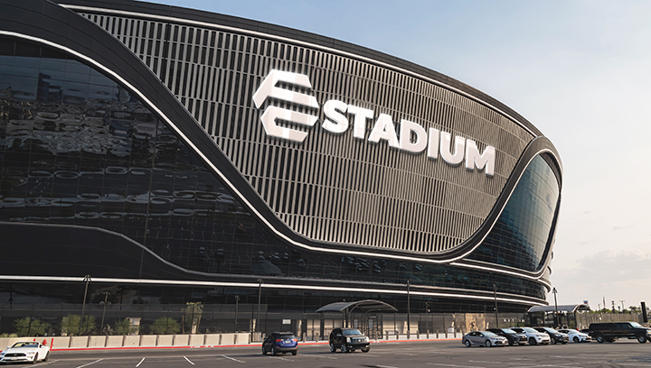 large custom arena signage in white displaying the brand name and logo
