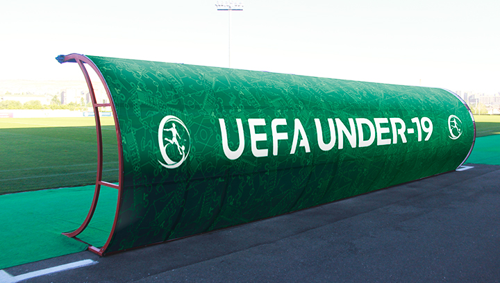 UEFA soccer field signage displaying the championship name and logo made of vinyl