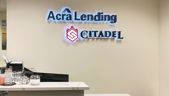 Acra Lending light up bank sign displaying the brand name and logo made of aluminum