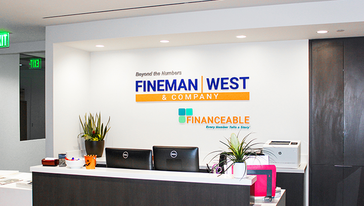Fineman West interior bank signage made of acrylic for reception branding