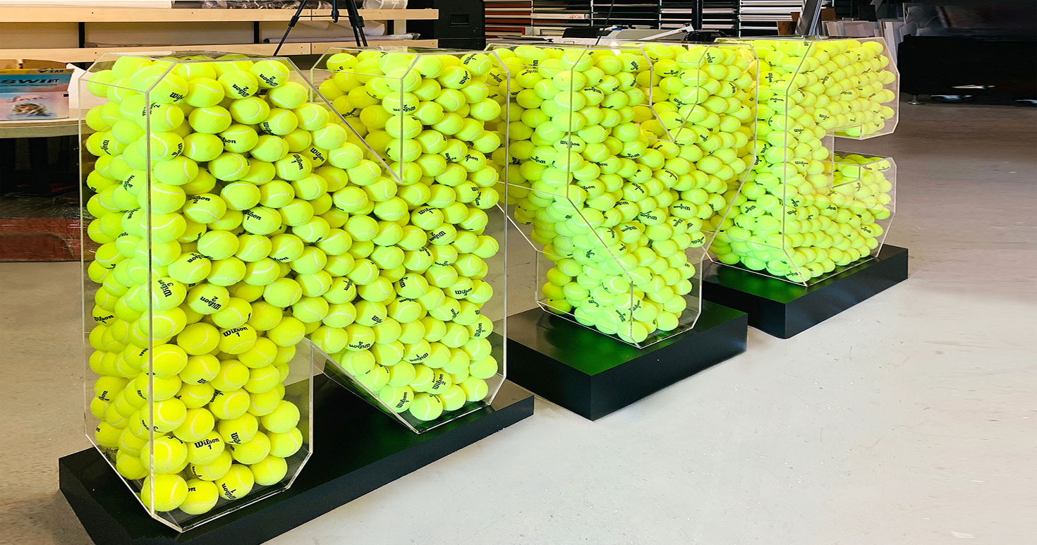 3D NYC acrylic letters with green tennis balls