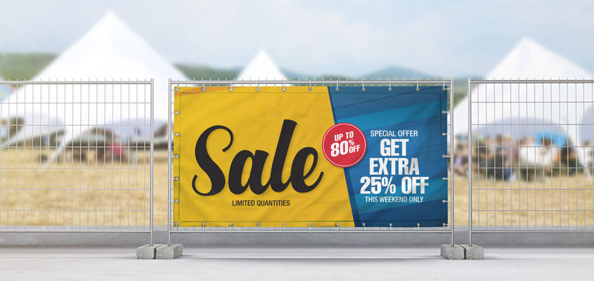 Sale banner example on barrier for outdoor event marketing