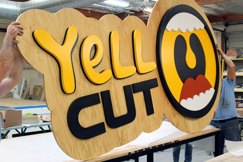 Yell Cut wooden solution for event branding-FrontSigns