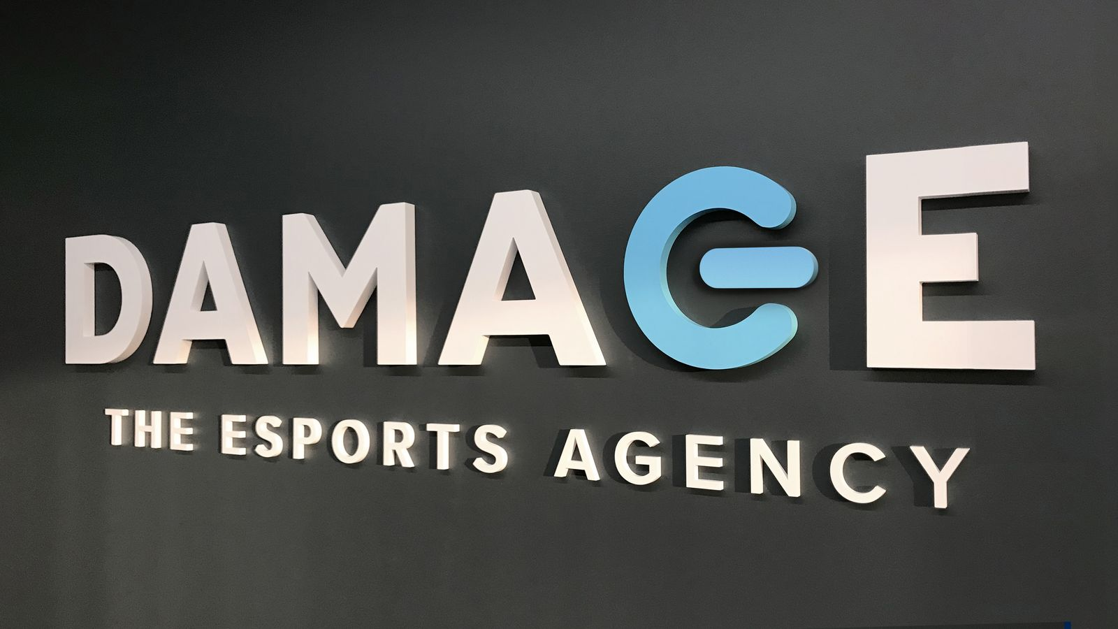 Damage - The Esports Agency 3d office sign letters displaying the company name made of acrylic for interior branding
