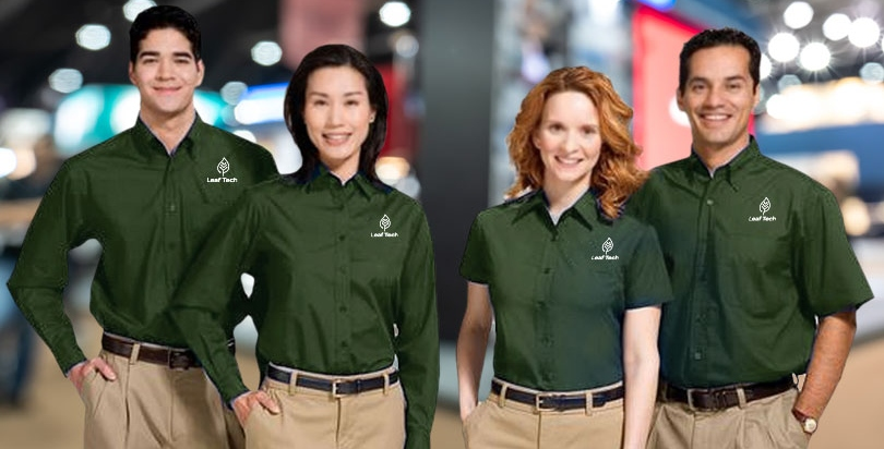 Staff at expo wearing green branded shirts