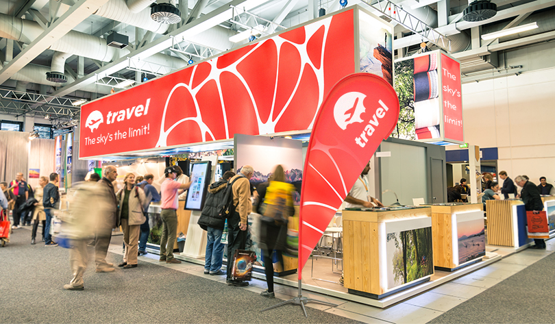 Travel trade show booth design example with flag