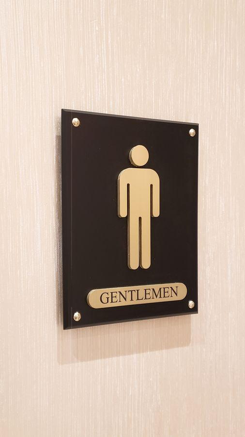 wall-mounted interior sign with a male icon and the word Gentlemen made of aluminum for lobby lavatory wayfinding