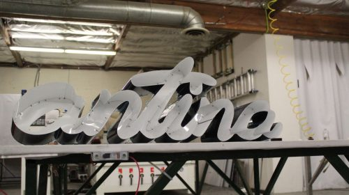 Antina 3d metal letters with LED wires inside it and made of aluminum during the signage repairing