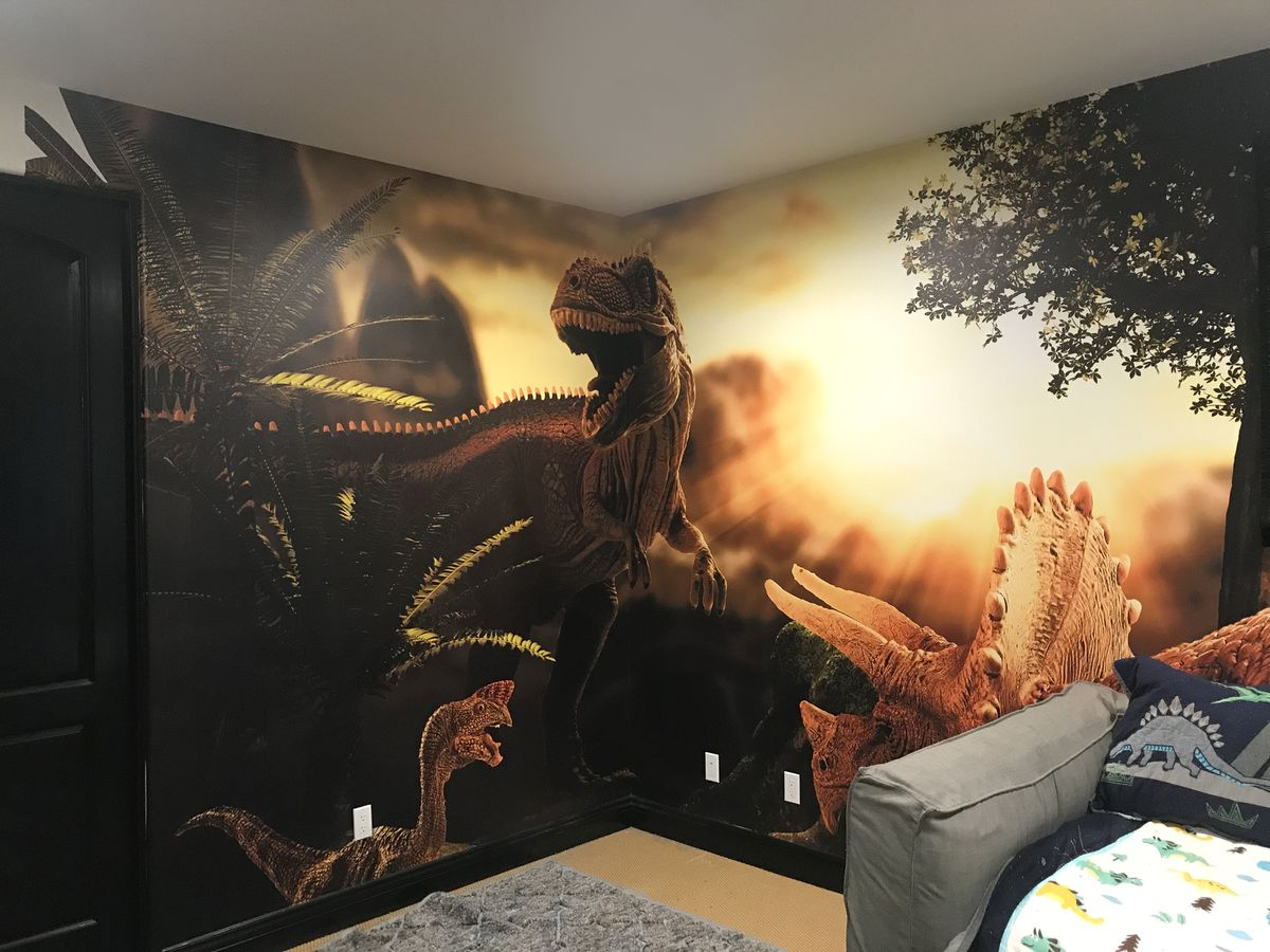custom interior wall sign with large prints of dinosaurs made of opaque vinyl for decorating