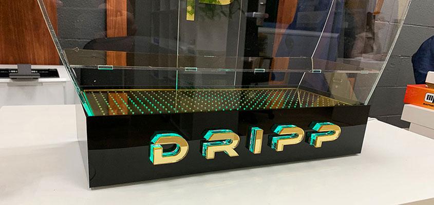 Dripp illuminated business stand design