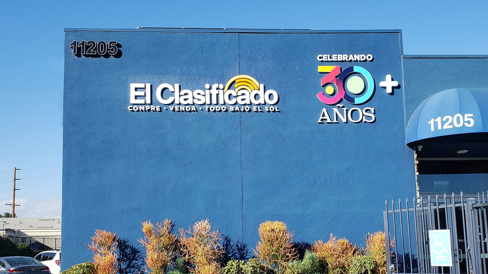 El Clasificado custom 3d sign painted in bright colors with the brand logo, name and address made of PVC for outdoor branding