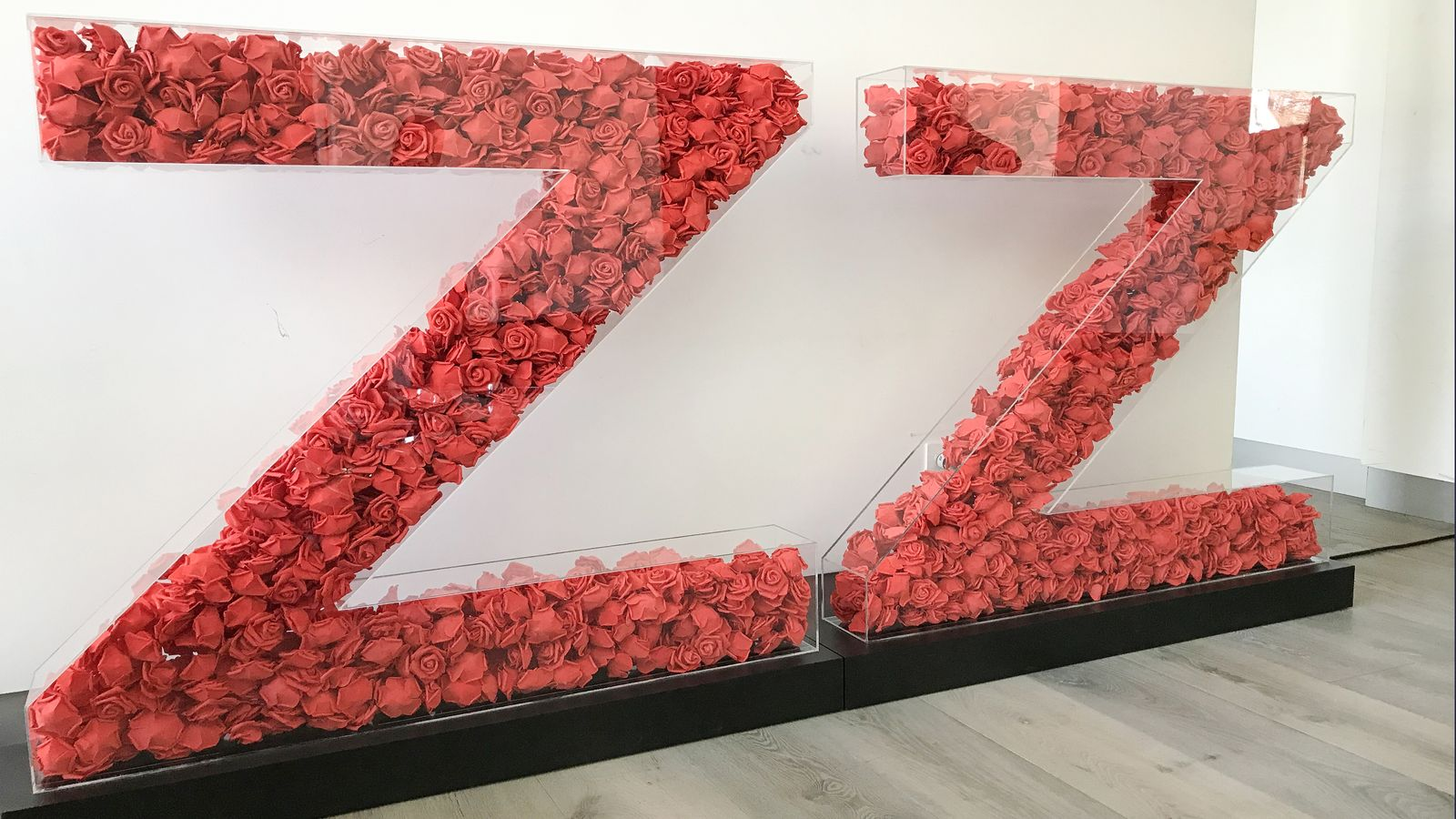 free-standing 3d sign letters in a big size filled with artificial roses and made of acrylic and aluminum for event branding