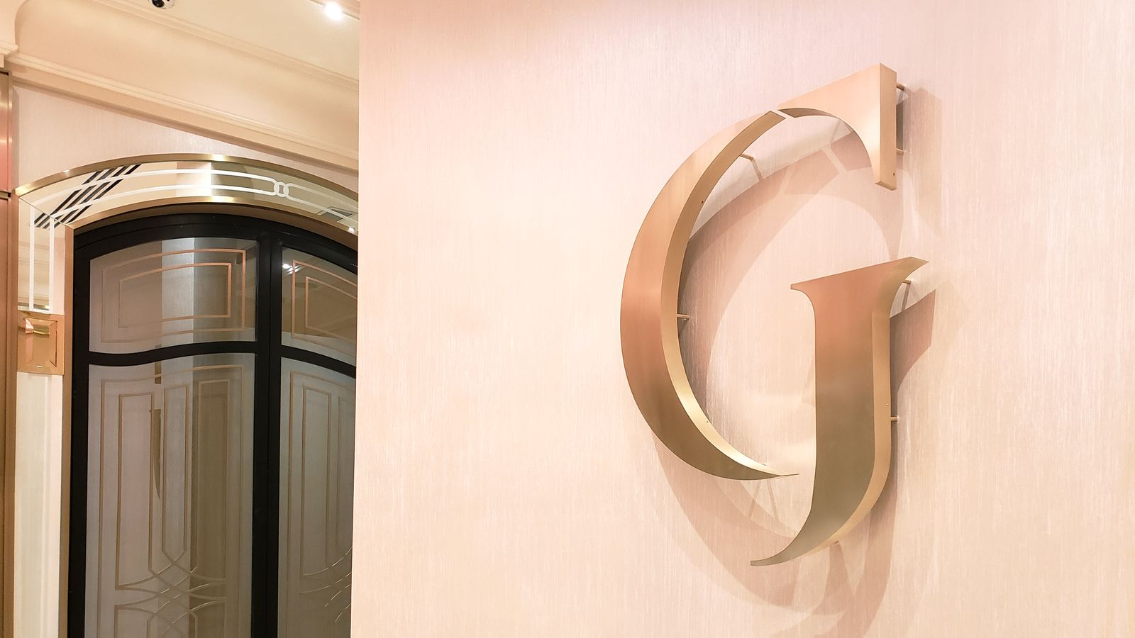 Grand Venue 3d logo sign with the letter G made of aluminum for interior branding
