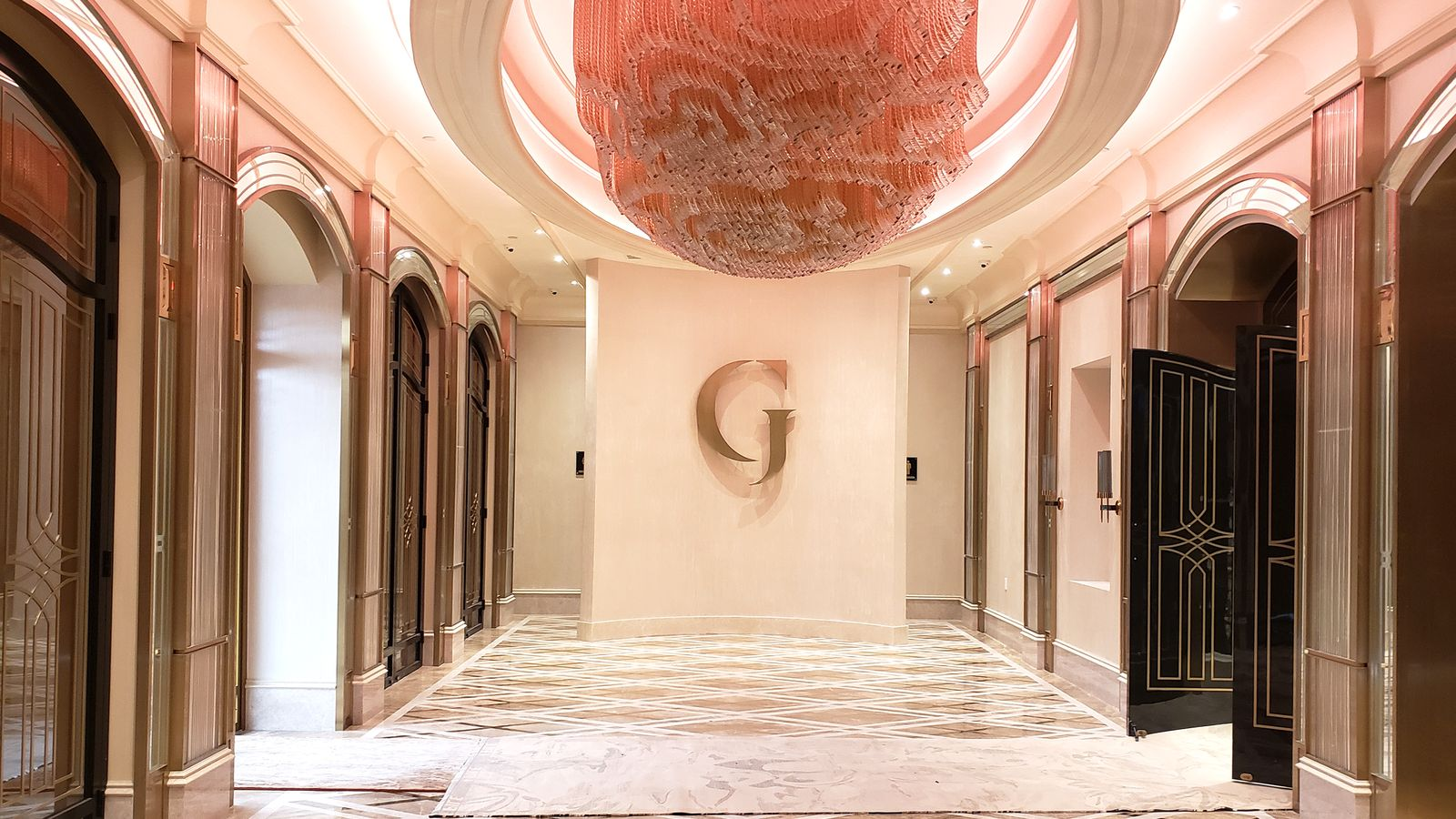 Grand Venue interior logo signage displaying the letter G made of aluminum for branding
