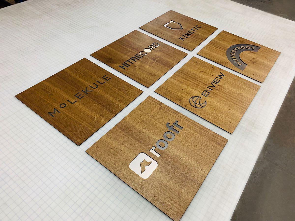 Multiple wooden nameplates