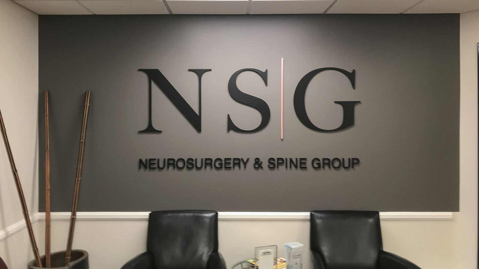 NSG Neurosurgery & Spine Group 3d acrylic letters in black displaying the brand name