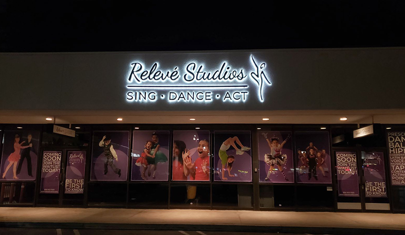 Relieve Studios backlit business logo-Frontsigns