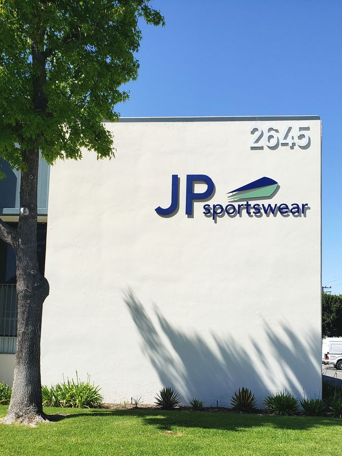 JP Sportswear 3d metal sign with the company name, logo and address number made of aluminum for storefront branding