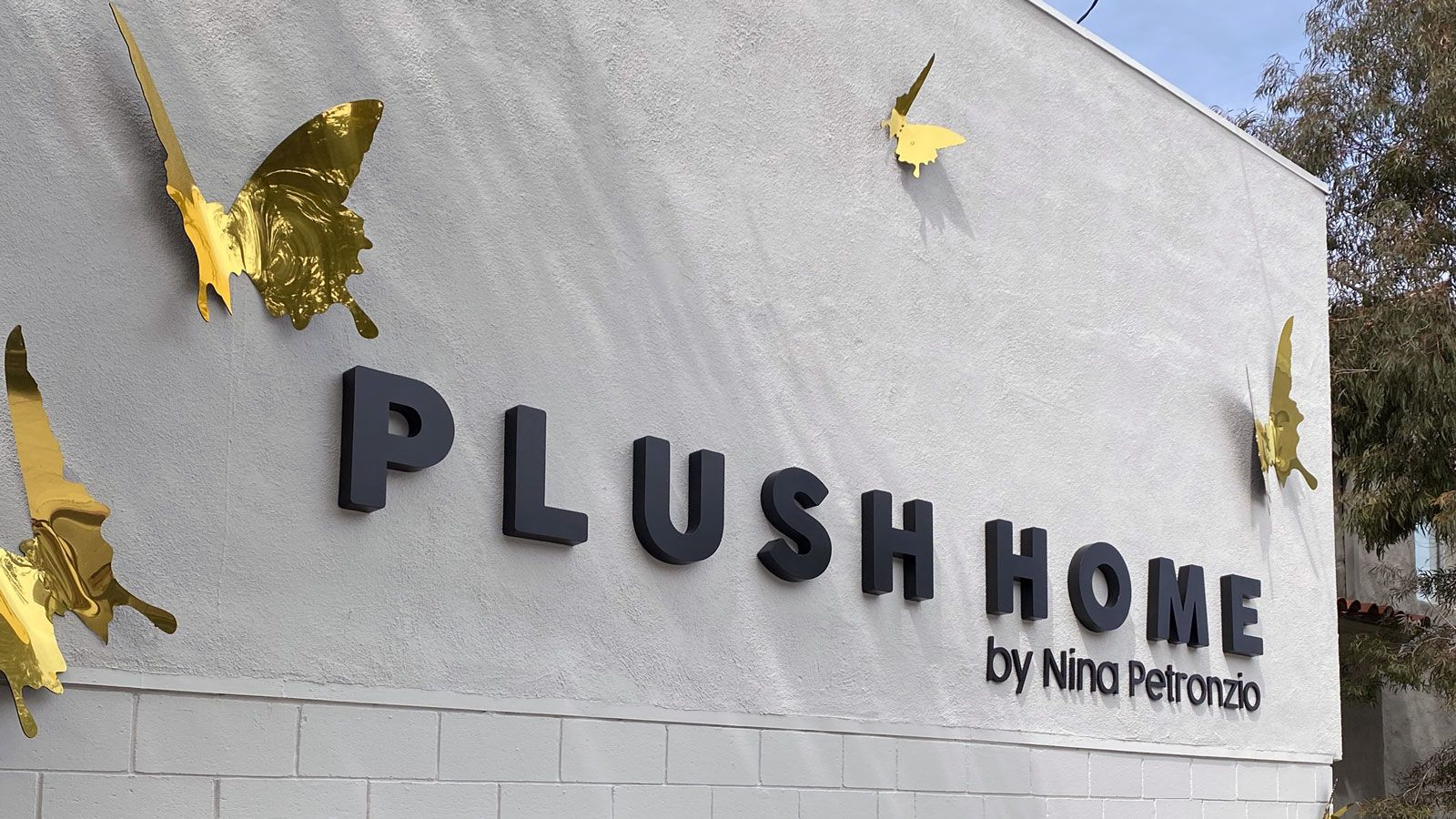 Plush Home custom 3d sign with golden decorative butterflies made of aluminum for storefront branding