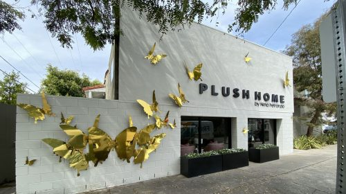 plush home storefront sign