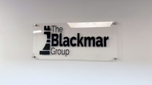 the black group acrylic sign