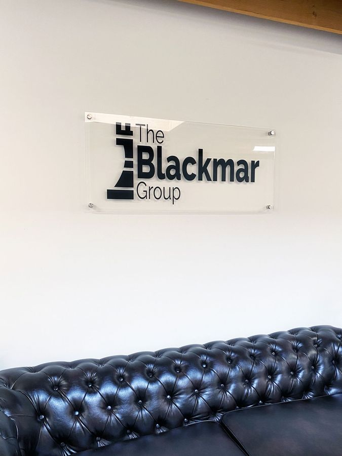 the black group office sign