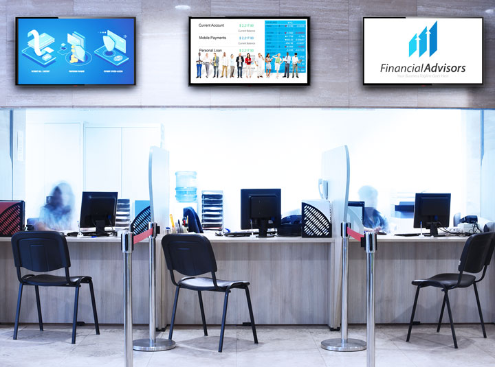 Financial Advisors bank interior with screens