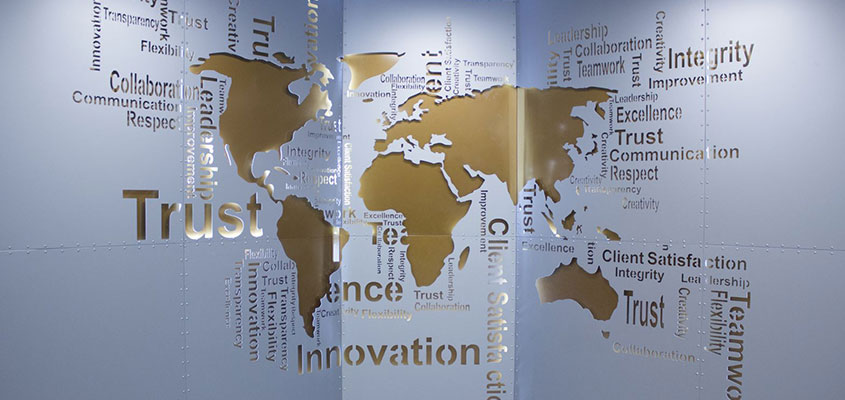 world map wall design in a bank office